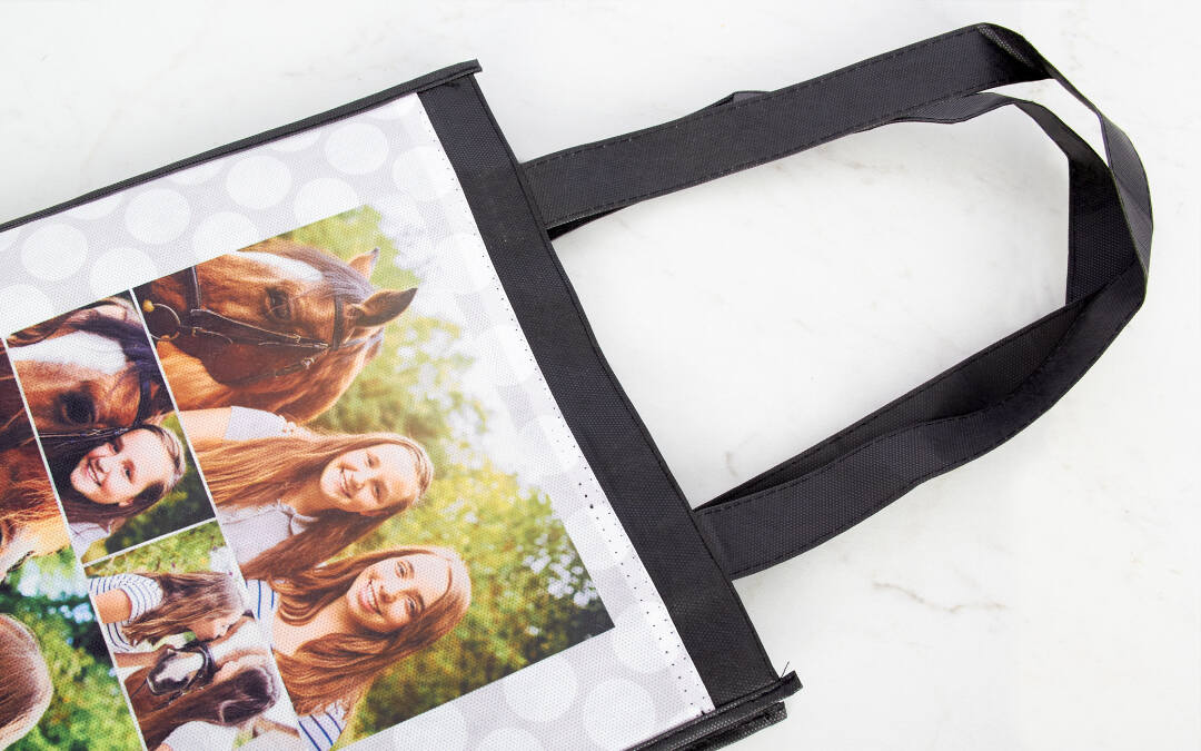 You can't beat our reusable grocery bags for any errands, from grocery shopping to soccer practice. Each durable, reusable bag includes sturdy handles with extra stitching to handle heavier loads. Each bag is 12.75 inches tall by 11.5 inches wide, making it perfect for on-the-go use. Your designs will print in vivid color on both sides of the bag (the same design will print on both sides). With this reusable grocery bag voucher two-pack, you can customize each bag with a different design.