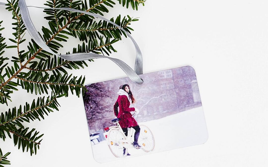 Each ornament comes with a festive ribbon, perfect for hanging your photo ornament any time of the year.